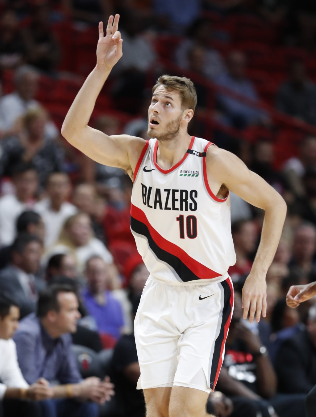 Portland Trail Blazers forward Jake Layman celebrates a three-point shot during the first half of an NBA basketball game against the Miami Heat, Satur...