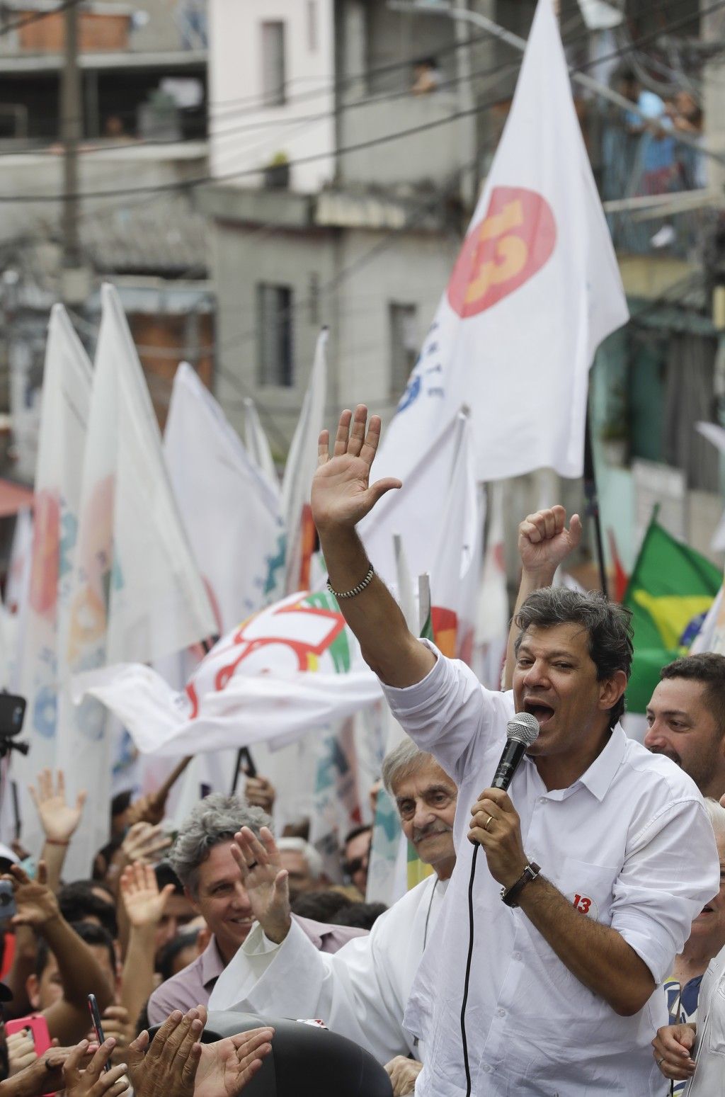Fernando Haddad, Brazil's presidential candidate for the Workers' Party, speaks during a campaign rally at the Heliopolis slum of Sao Paulo, Brazil, S...
