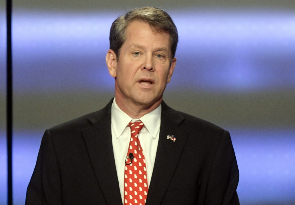 FILE - In this May 20, 2018, file photo, Georgia Republican gubernatorial candidate Brian Kemp participates in a debate in Atlanta.  Former President ...