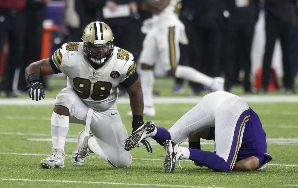 New Orleans Saints defensive tackle Sheldon Rankins, left, celebrates after sacking Minnesota Vikings quarterback Kirk Cousins during the second half