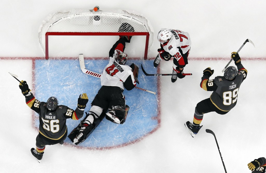 Vegas Golden Knights right wing Alex Tuch, right, celebrates after scoring against Ottawa Senators goaltender Craig Anderson (41) during overtime of a...