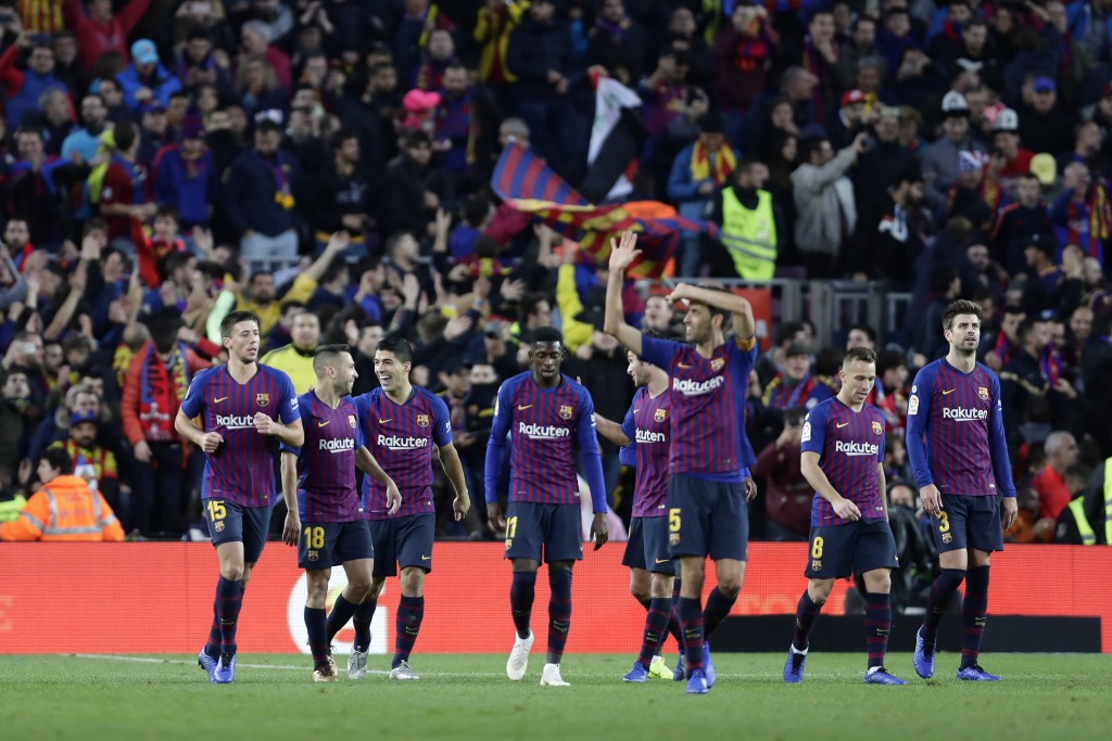 Barcelona players celebrate during the Spanish La Liga soccer match between FC Barcelona and Real Madrid at the Camp Nou stadium in Barcelona, Spain,