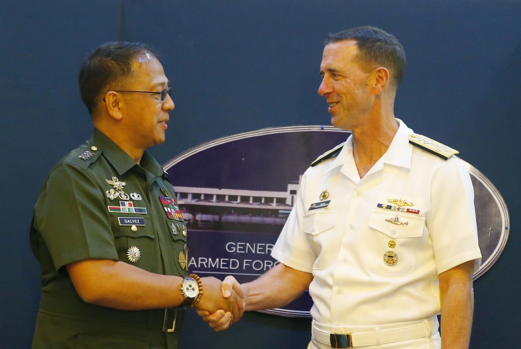 Philippine Armed Forces Chief Gen. Carlito Galvez Jr., left, and Adm. John Richardson, chief of Naval Operations of the U.S. Navy, shake hands prior t...