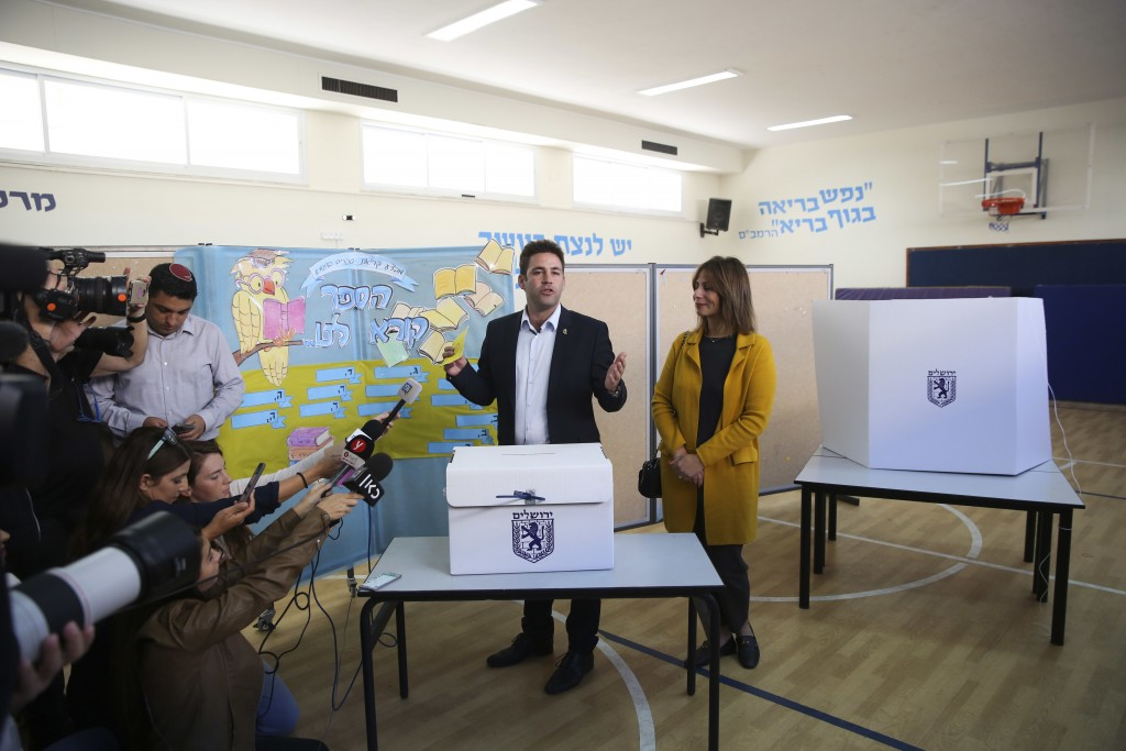Mayoral candidate Ofer Berkovitch and his wife Dina arrive to cast their votes at a polling station during the municipal elections in Jerusalem, Tuesd...