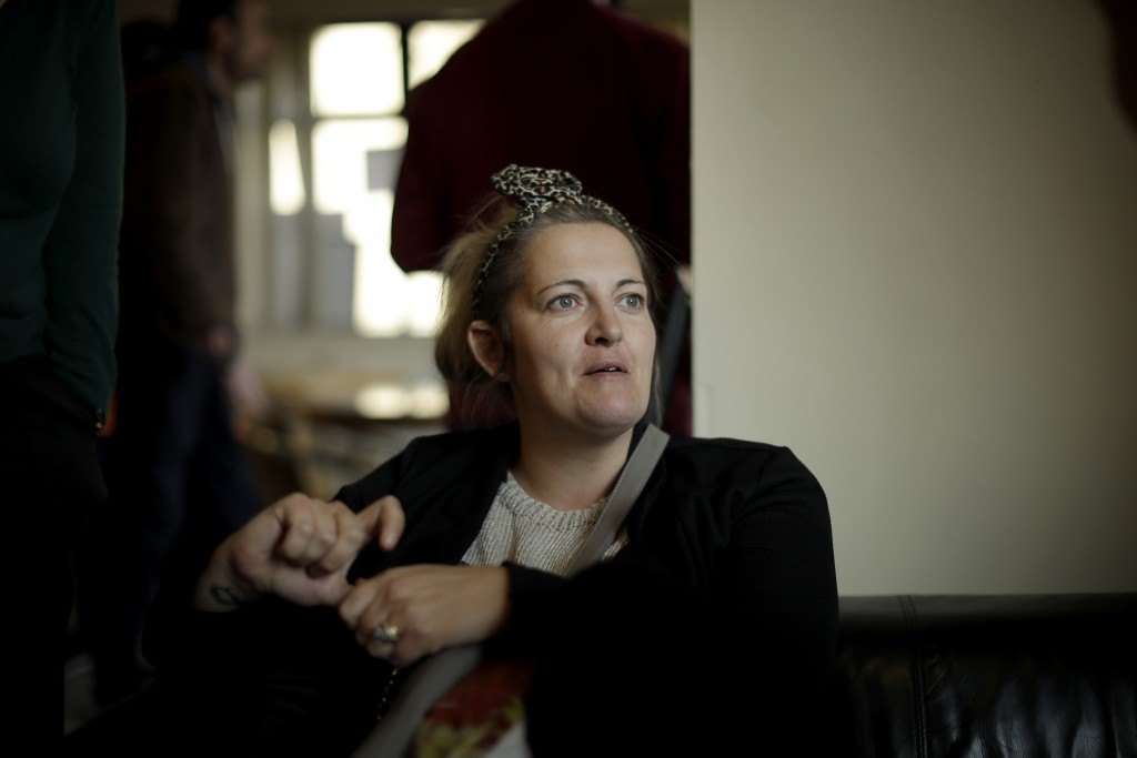 Director and Events organizer Gemma Flower speaks as she is interviewed by The Associated Press at the Ivybridge estate community centre in west Londo...