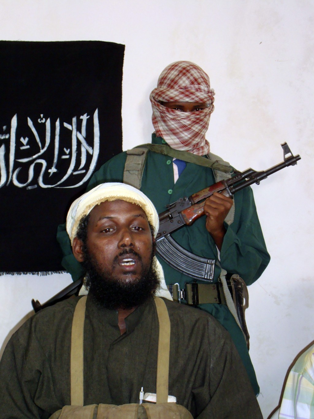 FILE - In this Sunday, Dec.14, 2008 file photo, Mukhtar Robow, then spokesman for the al-Qaida-linked militant group al-Shabab, speaks to the media in