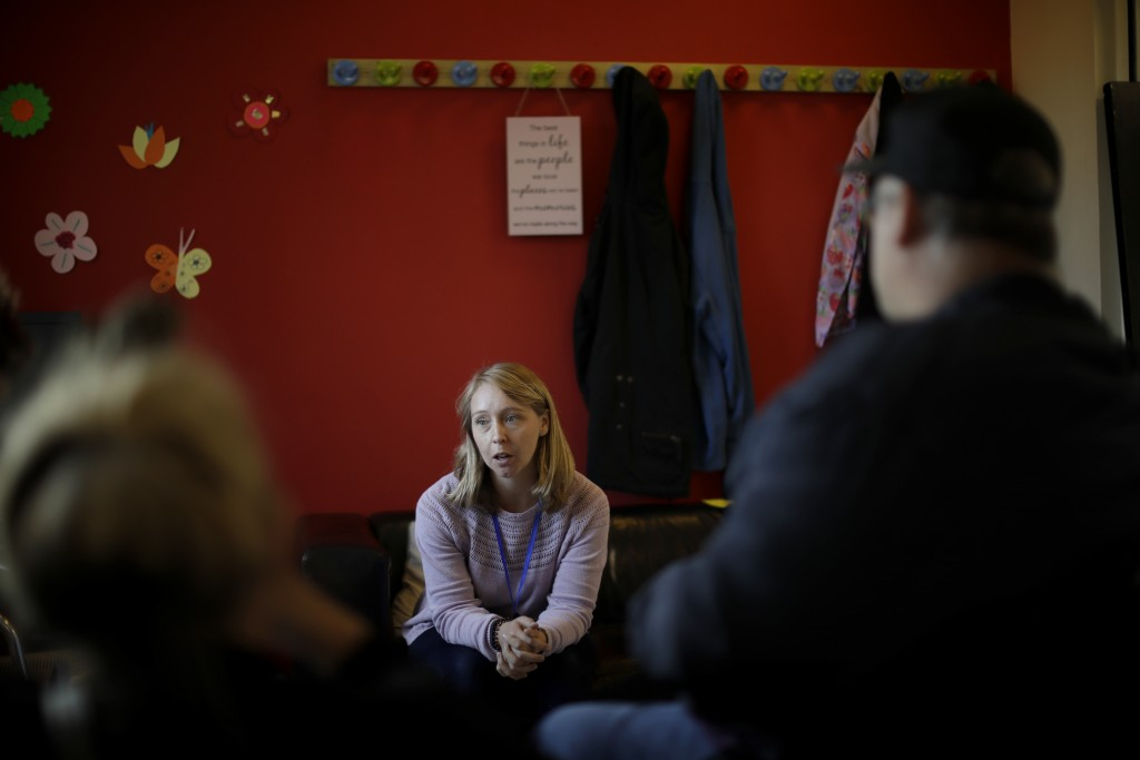Foodbank manager Nikki Fletcher speaks as she is interviewed by The Associated Press at the Ivybridge estate community centre in west London, Thursday...