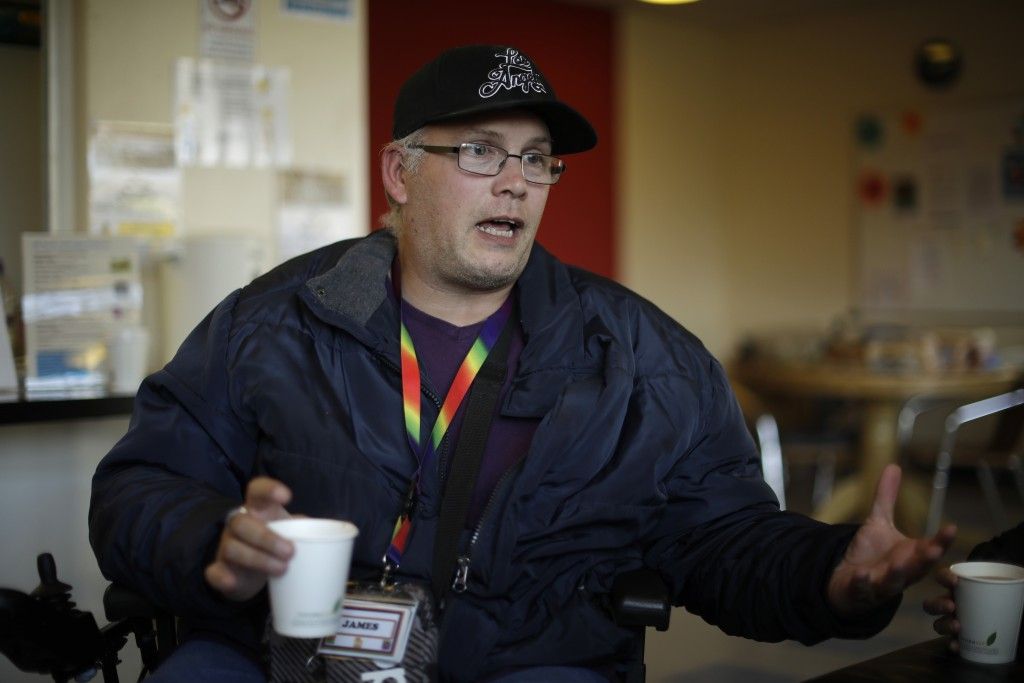 Support worker James Fox speaks as he is interviewed by The Associated Press at the Ivybridge estate community centre in west London, Thursday, Oct. 2...