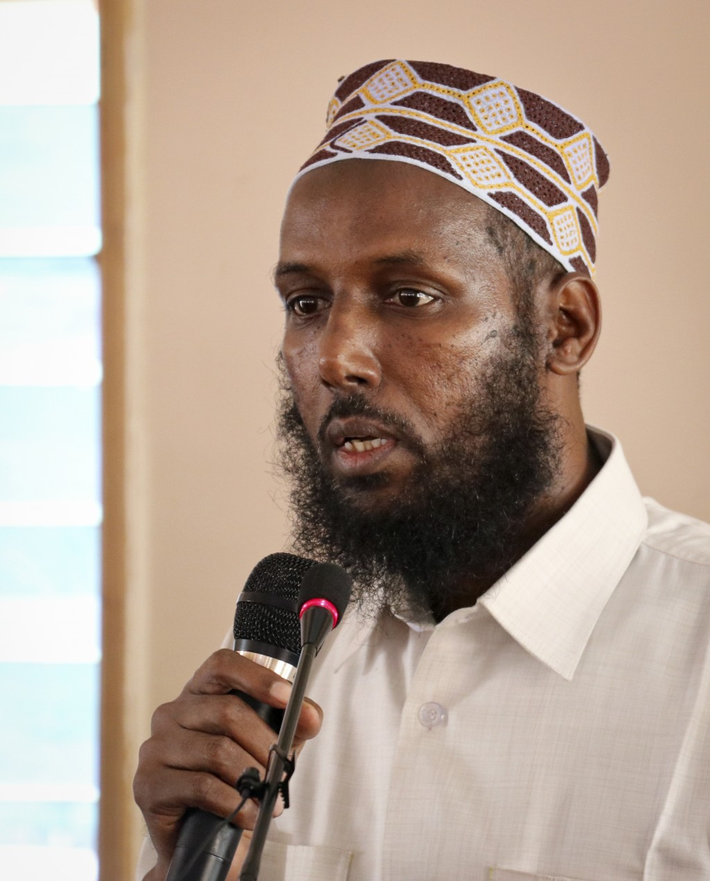 In this photo taken Wednesday, Oct. 10, 2018, Mukhtar Robow, who was once deputy leader of Africa's deadliest Islamic extremist group the al-Qaida-lin