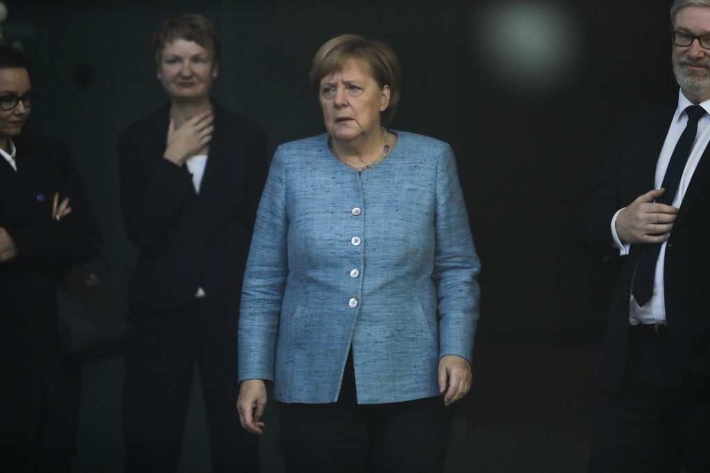German Chancellor Angela Merkel arrives at the foyer of the chancellery to welcome the Prime Minister of Ethiopia, Abiy Ahmed Ali, for a meeting at th
