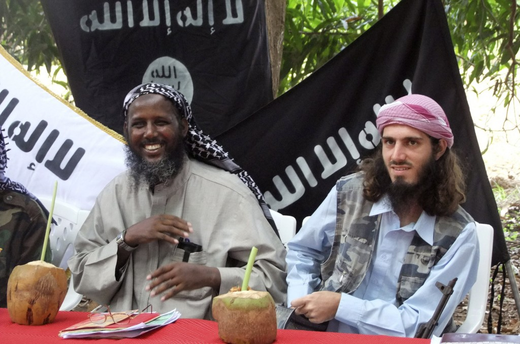 FILE - In this Wednesday, May 11, 2011 file photo, then deputy leader of Somalia's al-Qaida-linked militant group al-Shabab, Mukhtar Robow, left, give