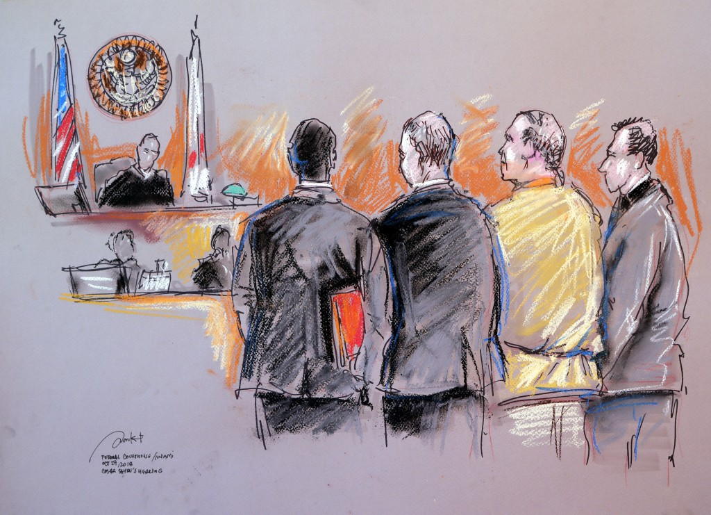 In this courtroom sketch, Cesar Sayoc, second from right, appears in federal court, Monday, Oct. 29, 2018, in Miami. Sayoc is accused of sending pipe