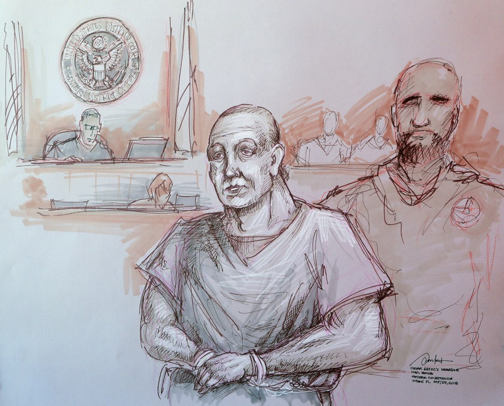 In this courtroom sketch, Cesar Sayoc, left, appears in federal court, Monday, Oct. 29, 2018, in Miami. Sayoc is accused of sending pipe bombs to prom