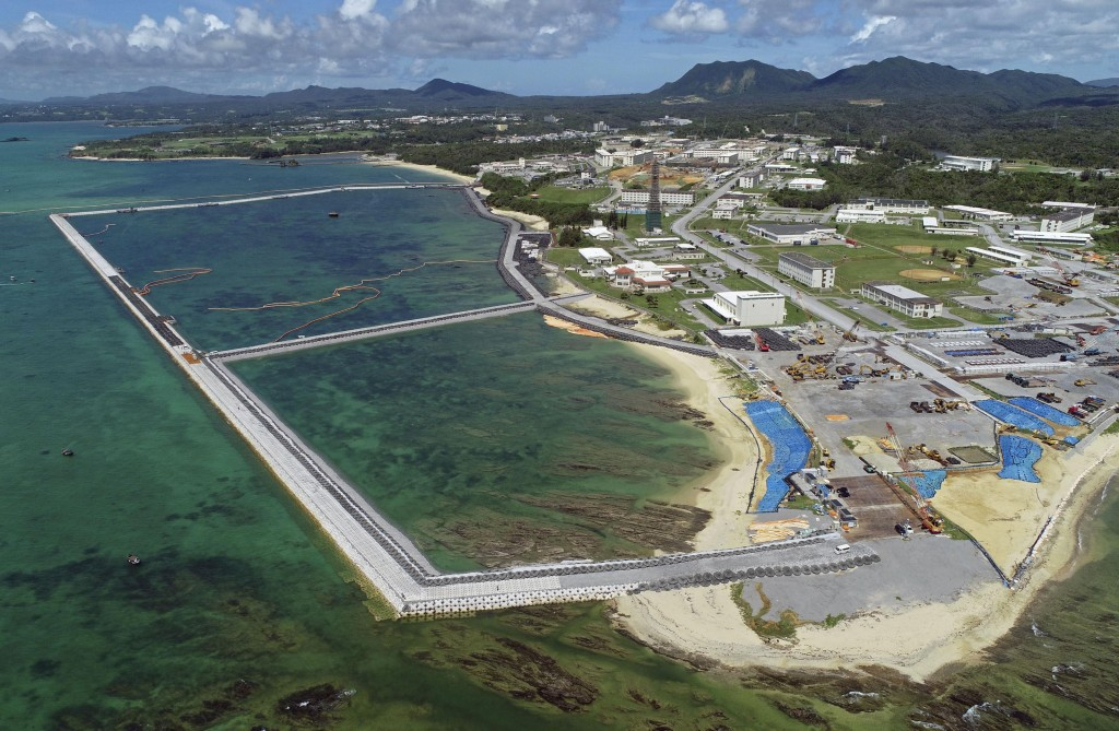 FILE - This Aug. 2018, file aerial photo shows preliminary construction work off Henoko, in Nago city, Okinawa prefecture, Japan, where the Japanese g...
