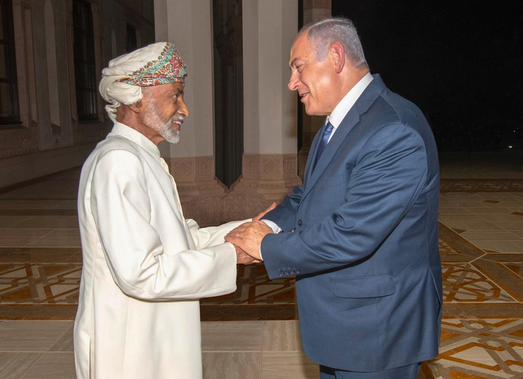 FILE- In this Friday, Oct. 26, 2018 file photo, released by Oman News Agency, Oman's Sultan Qaboos, left, receives Israeli Prime Minister Benjamin Net...