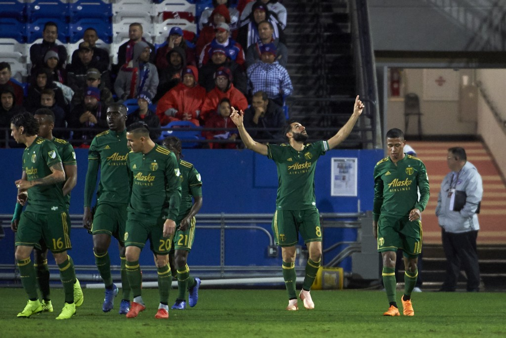 Portland Timbers midfielder Diego Valeri (8) celebrates after scoring a goal against FC Dallas during the first half of an MLS soccer playoff match in...