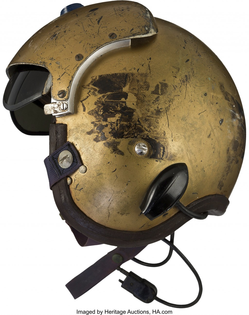 This undated photo provided by Heritage Auctions shows a helmet worn by John Glenn during the history-making flight, dubbed Project Bullet, in which t...