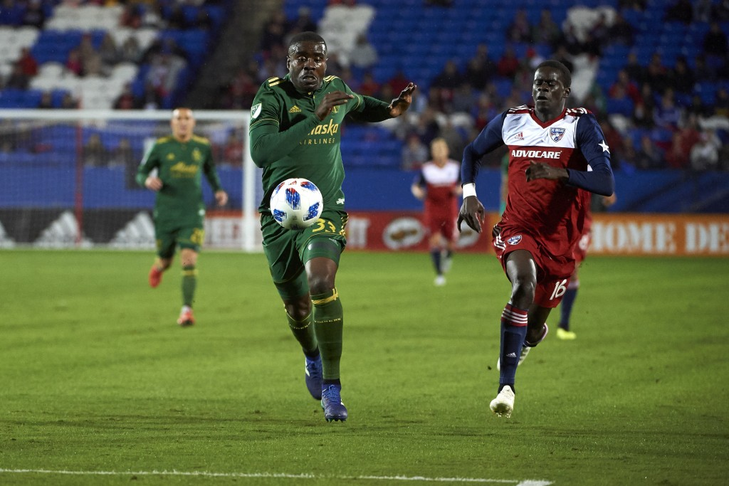 Portland Timbers defender Larrys Mabiala (33) controls the ball next to FC Dallas forward Dominique Badji (16) during the first half of an MLS soccer ...