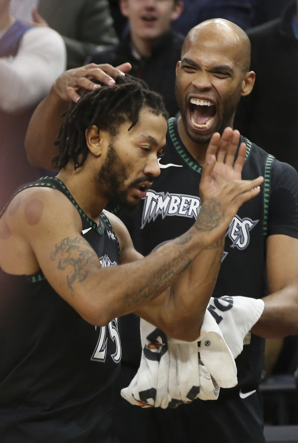 f5d964db Minnesota Timberwolves' Taj Gibson, right congratulates Derrick Rose after  the Timberwolves defeated the Utah
