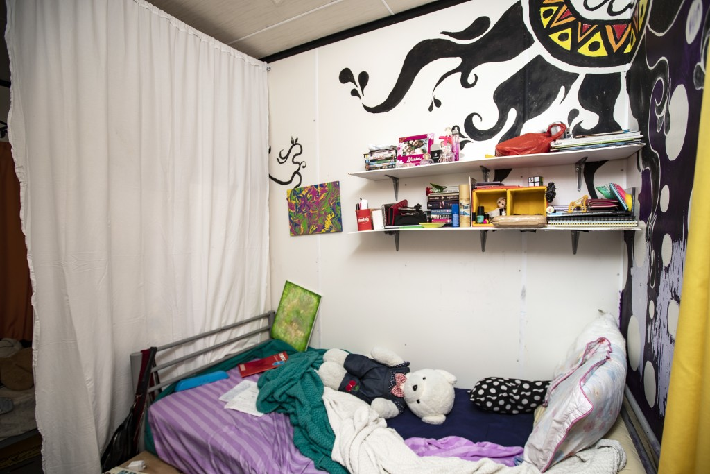 FILE - This Sept. 4, 2018, file photo shows the bedroom of a teenage refugee in the Nibok refugee settlement. Australia aims to remove all asylum seek