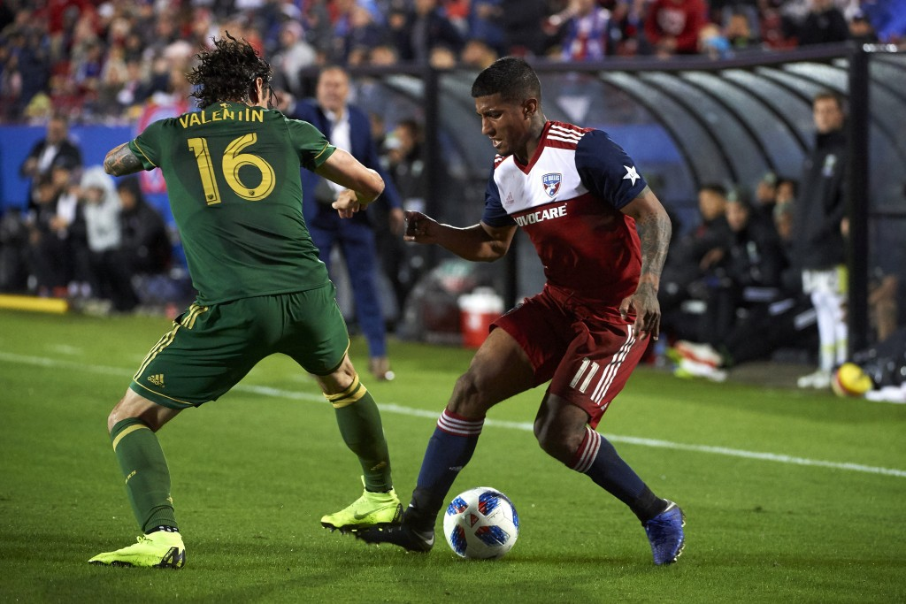 FC Dallas midfielder Santiago Mosquera (11) controls the ball against Portland Timbers defender Zarek Valentin (16) during the first half of an MLS so...