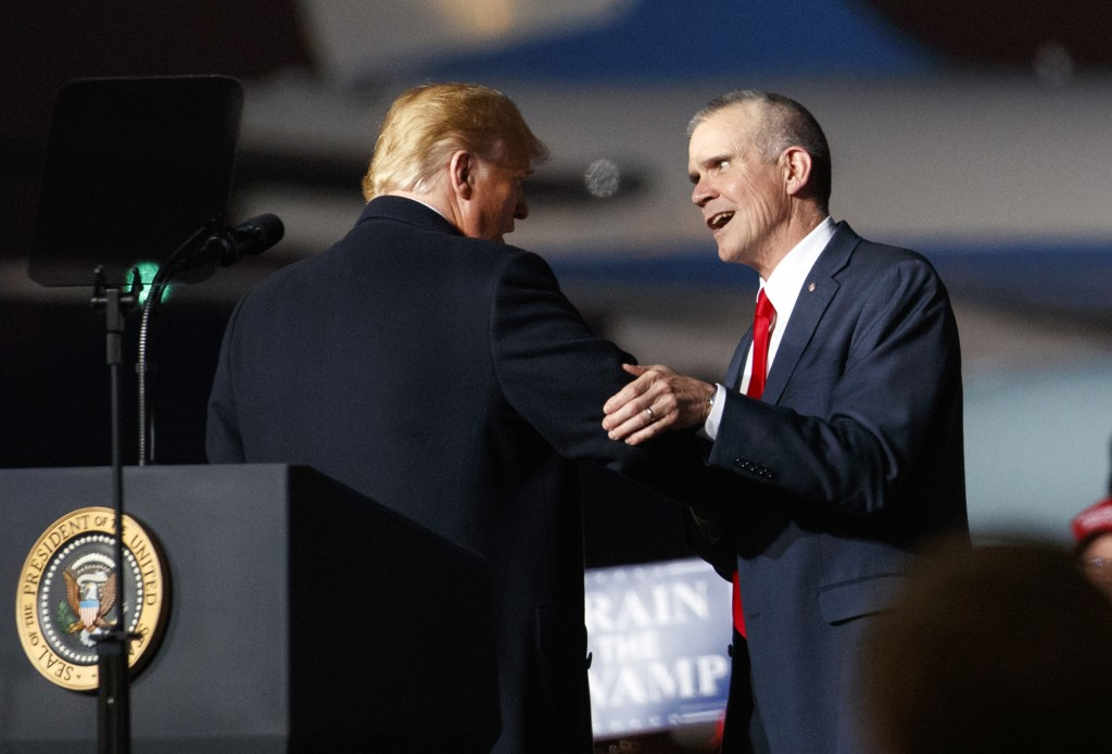 FILE - In this Oct. 18, 2018 file photo President Donald Trump and Montana State Auditor Matt Rosendale, who is running against Sen. Jon Tester, D-Mon...