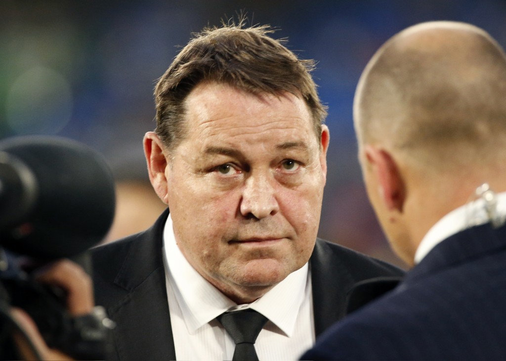 In this Oct. 27, 2018, photo, New Zealand All Blacks coach Steve Hansen, center, speaks to the media after their Bledisloe Cup rugby test against Aust