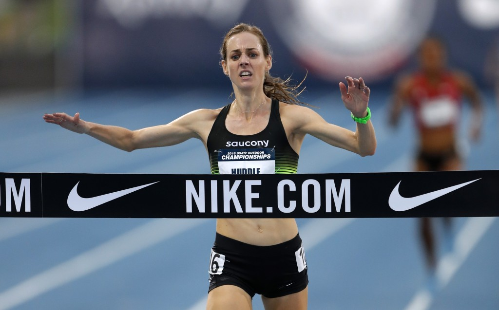 FILE- In this June 21, 2018, file photo, Molly Huddle crosses the finish line as she win the women's 10,000-meter run at the U.S. Championships athlet...