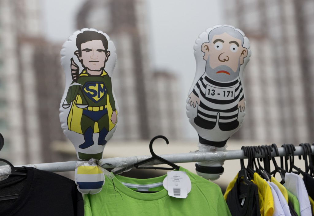 An inflatable doll of Judge Sergio Moro dressed as a super hero, left, stands by one of Brazil's former, jailed President Luiz Inacio Lula da Silva dr...