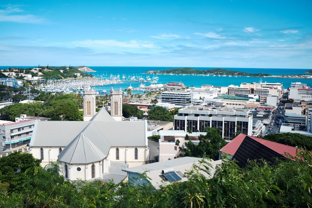 FILE - This Monday May 9, 2018 file photo, shows a general view of the bay of Noumea, the capital of New Caledonia with the Saint Joseph cathedral in