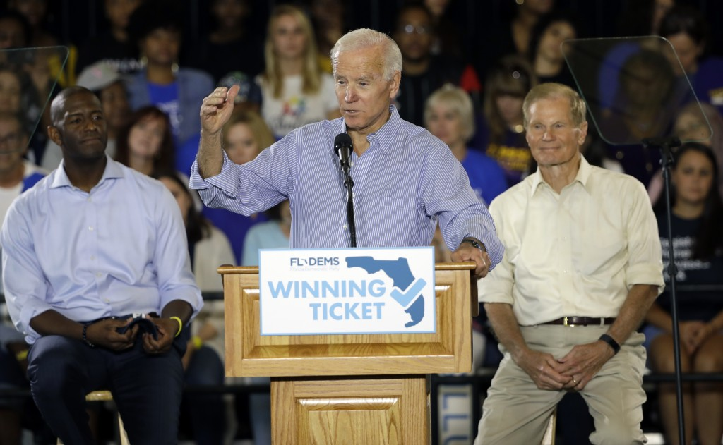 In this Oct. 22, 2018 photo former Vice President Joe Biden speaks during a campaign rally for Florida Democratic gubernatorial candidate Andrew Gillu...