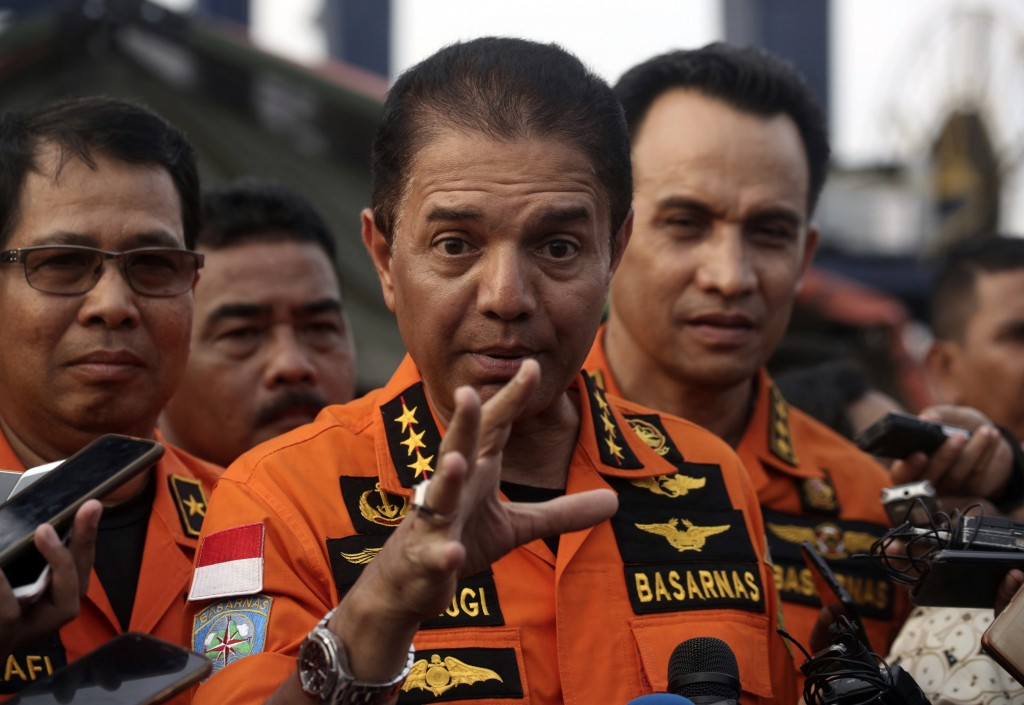 Chief of National Search and Rescue Agency Muhammad Syaugi, center, gestures as he speaks to the media at Tanjung Priok Port in Jakarta, Indonesia, Fr...