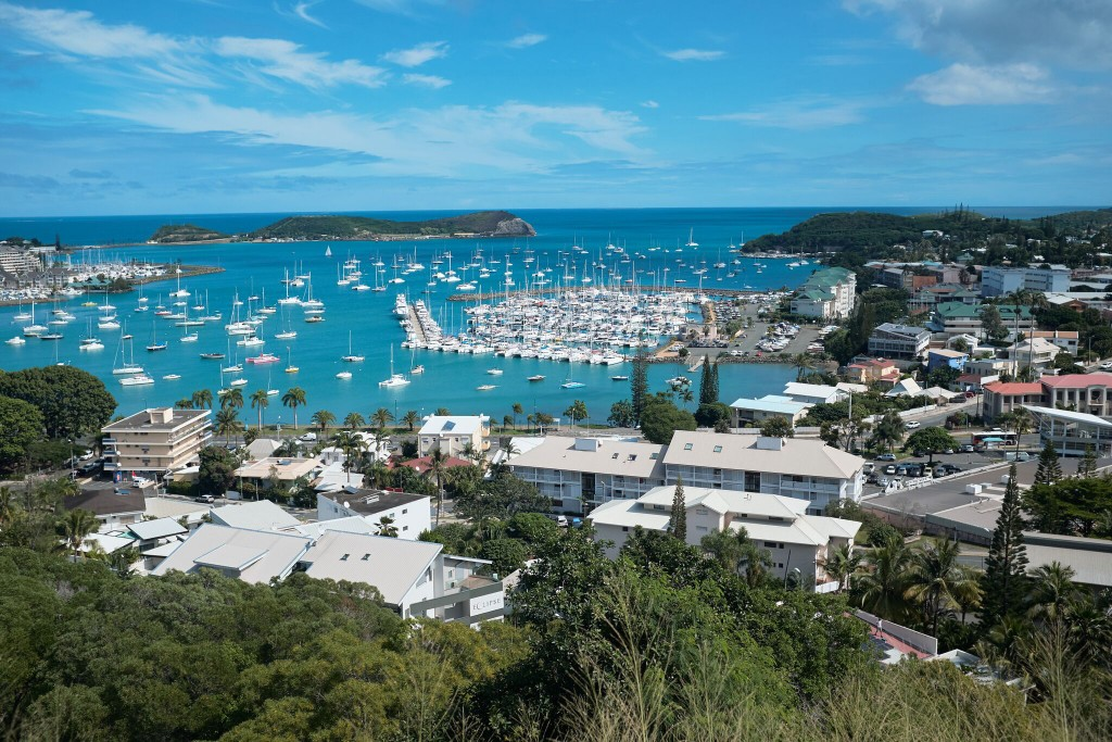 FILE - This Monday, May 9, 2018 file photo shows a general view of the bay of Noumea, the capital of New Caledonia with the yachting port in the backg...