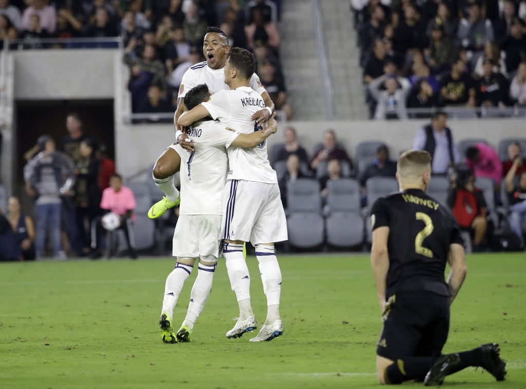 Real Salt Lake's Jefferson Savarino, Joao Plata, top, and Damir Kreilach celebrate after an own goal from Los Angeles FC gave them the lead during the...
