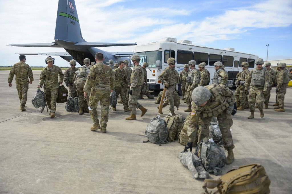 In this photo provided by the U.S. Air Force, soldiers from the the 89th Military Police Brigade, and 41st Engineering Company, 19th Engineering Batta...