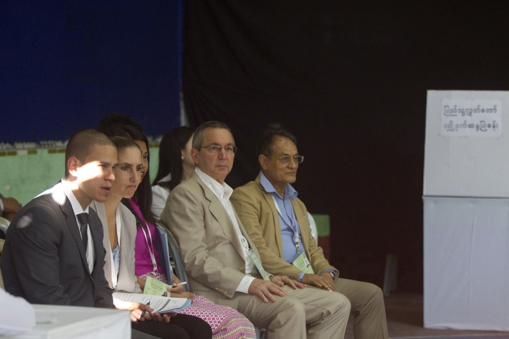 U.S. Ambassador to Myanmar  Scot Marciel, second right, sits along with other diplomats as he observes at a polling station in Yangon, Myanmar, Saturd...