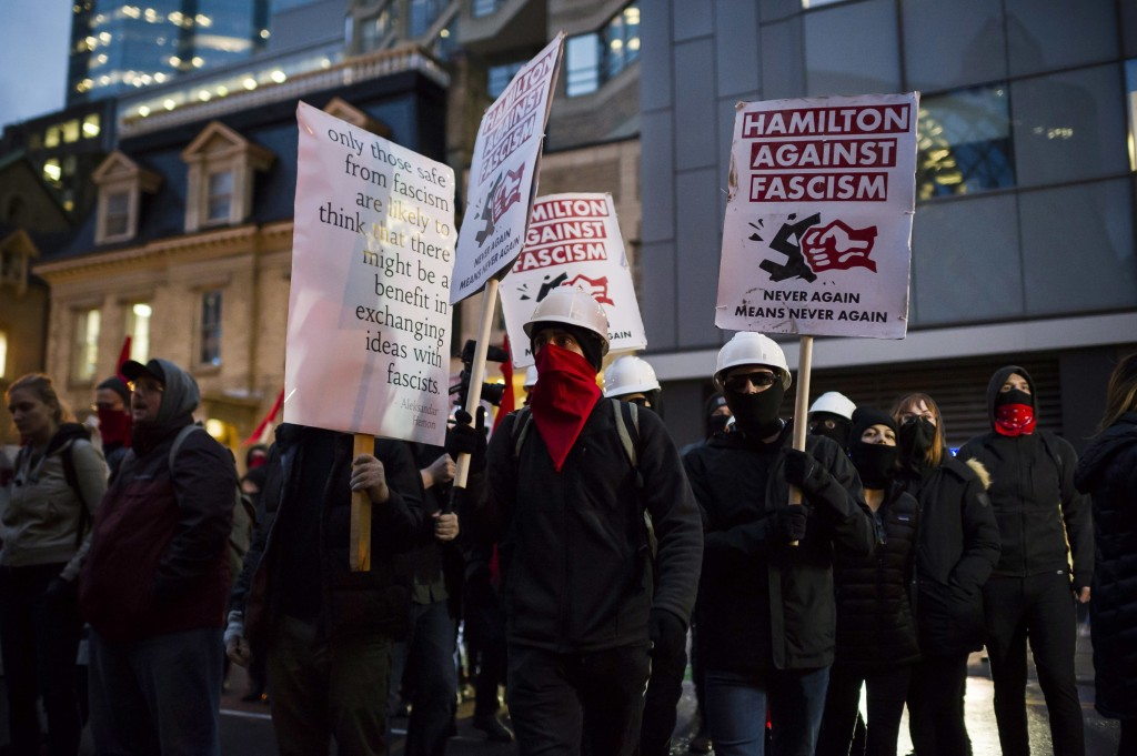 Protesters demonstrate outside a Toronto Munk debate featuring former White House chief strategist, Steve Bannon, and conservative commentator David F...