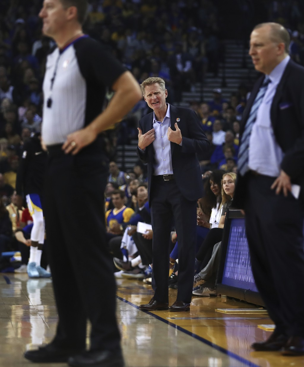 Golden State Warriors coach Steve Kerr, center, gestures to a referee during the first half of the team's NBA basketball game against the Minnesota Ti...