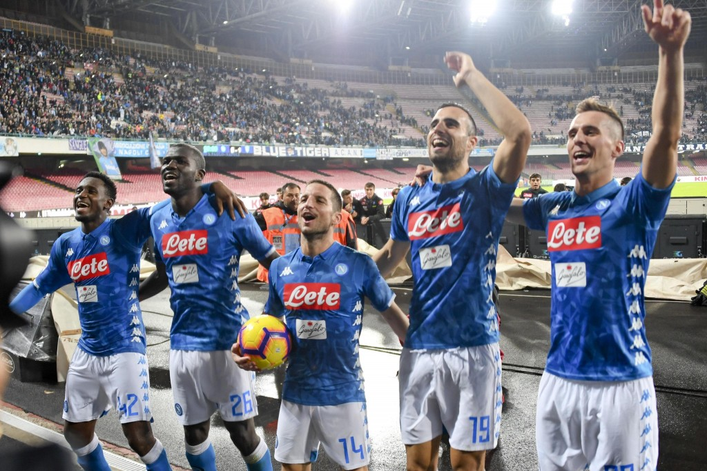 Napoli's forward Dries Mertens, center, celebrates with his teammates at the end of the Italian Serie A soccer match between Napoli and Empoli at the