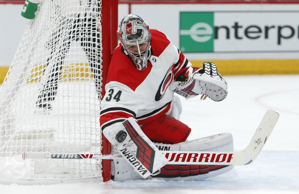Carolina Hurricanes goaltender Petr Mrazek makes a save against the Arizona Coyotes during the second period of an NHL hockey game Friday, Nov. 2, 201...