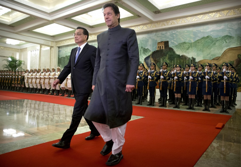 Chinese Premier Li Keqiang, left, and Pakistan's Prime Minister Imran Khan walk together during a welcome ceremony at the Great Hall of the People in