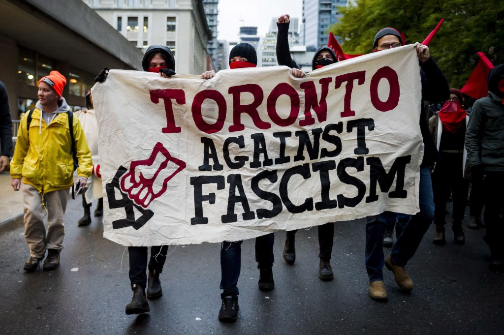 Protesters demonstrate outside a Toronto Munk debate featuring Steve Bannon, former White House chief strategist, and conservative commentator David F