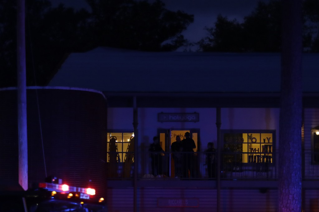 Police investigators work the scene of a shooting, Friday, Nov. 2, 2018, in Tallahassee, Fla. A shooter killed one person and critically wounded four ...