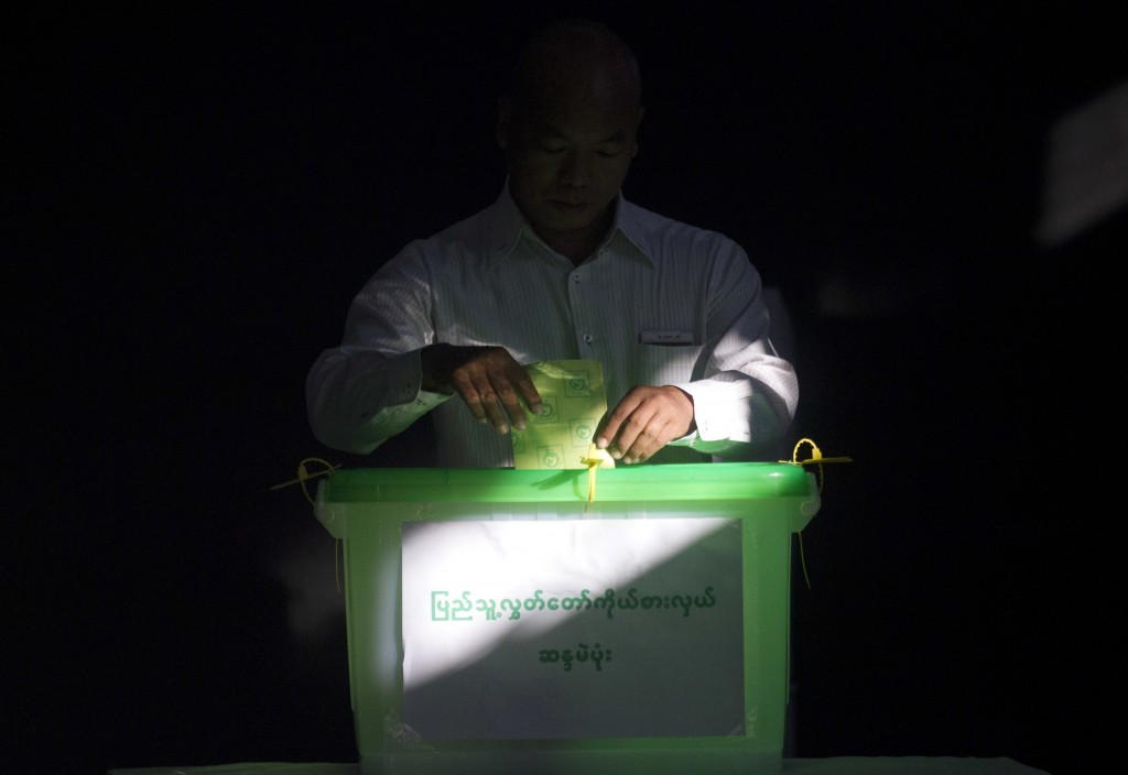 In this Saturday, Nov. 3, 2018, file photo, a voter casts his ballot at a polling station in Yangon, Myanmar. Myanmar staged by-elections Saturday in ...