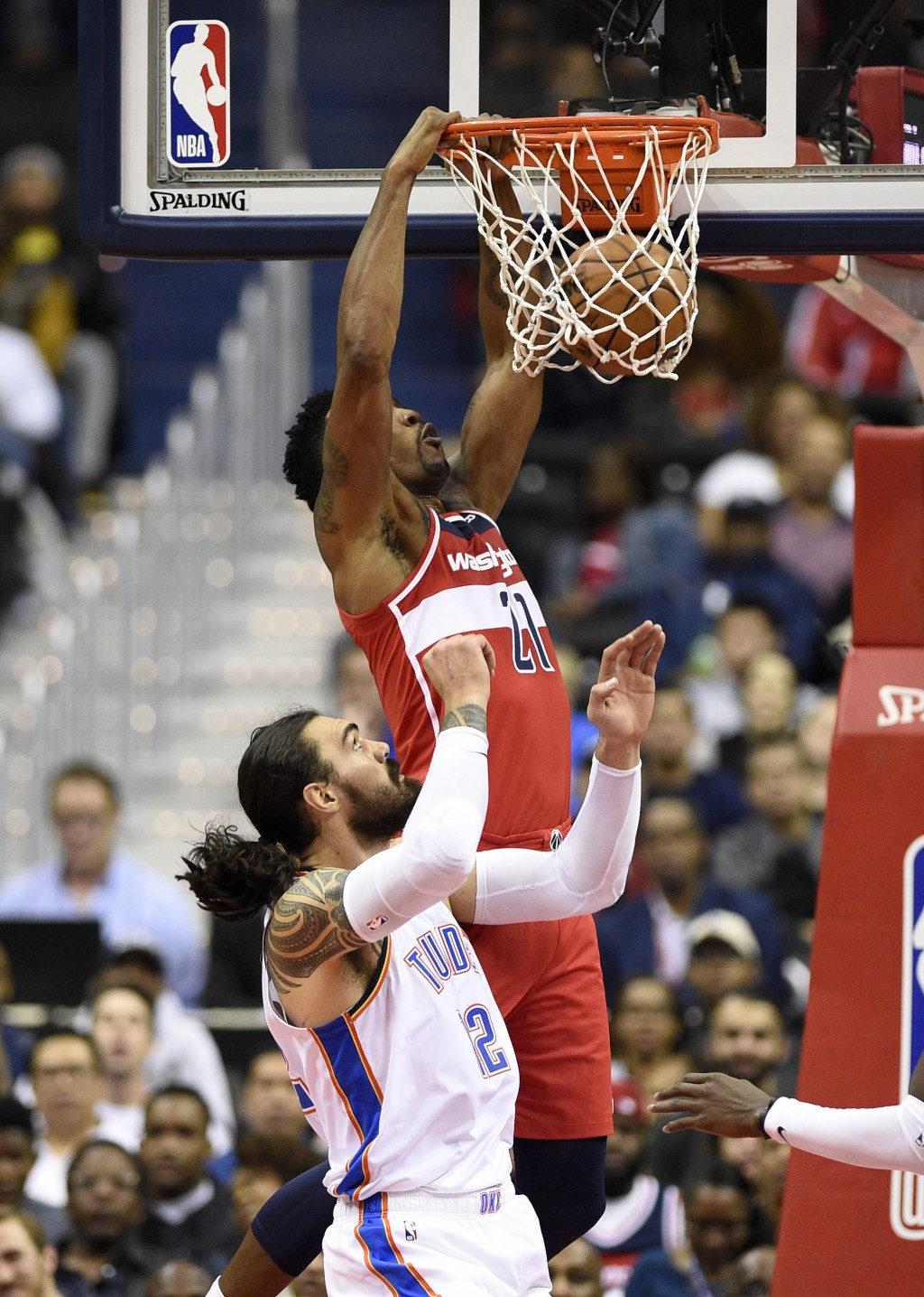 Washington Wizards center Dwight Howard (21) dunks over Oklahoma City Thunder center Steven Adams (12), of New Zealand, during the first half of an NB...