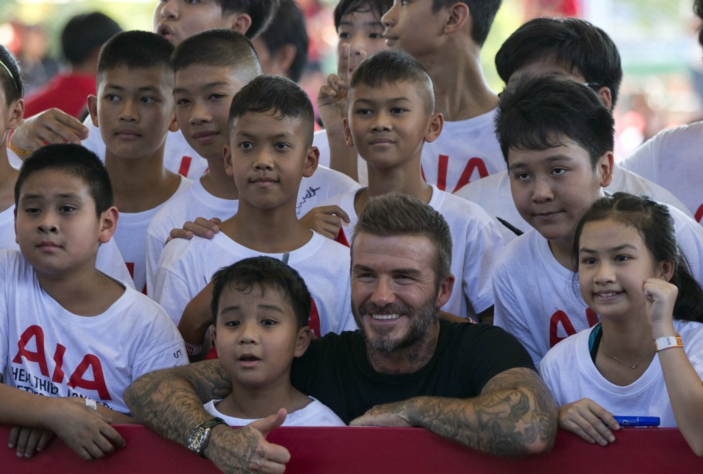 Retired footballer David Beckham poses for a group photograph during a sponsored promotional event in Bangkok, Thailand, Saturday, Nov 3, 2018. Beckha