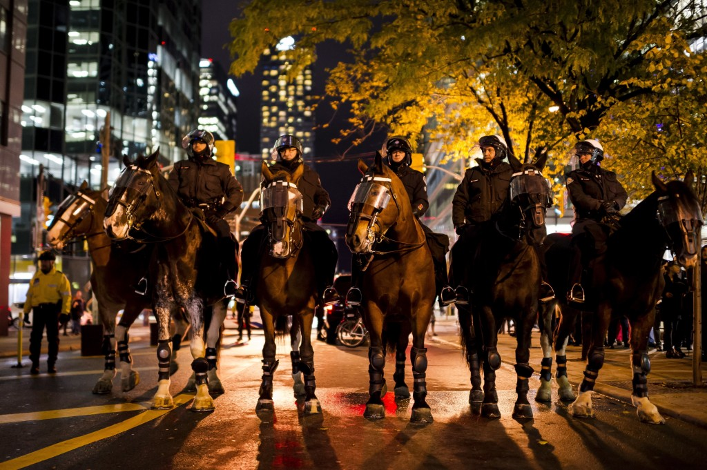 Mounted police form outside a Toronto Munk debate featuring former White House chief strategist Steve Bannon and conservative commentator David Frum i