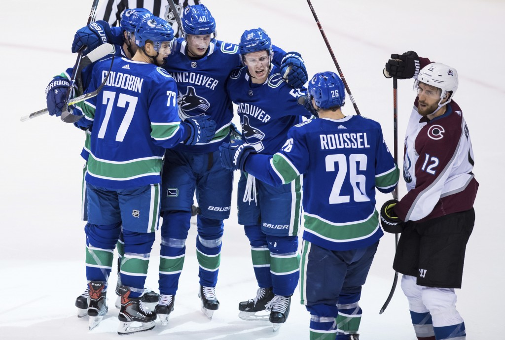 Vancouver Canucks' Derrick Pouliot; Nikolay Goldobin, of Russia; Elias Pettersson, of Sweden; Troy Stecher; and Antoine Roussel, of France, from left,...