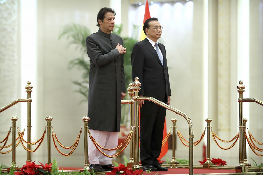 Pakistan's Prime Minister Imran Khan, left, and Chinese Premier Li Keqiang stand together during a welcome ceremony at the Great Hall of the People in...