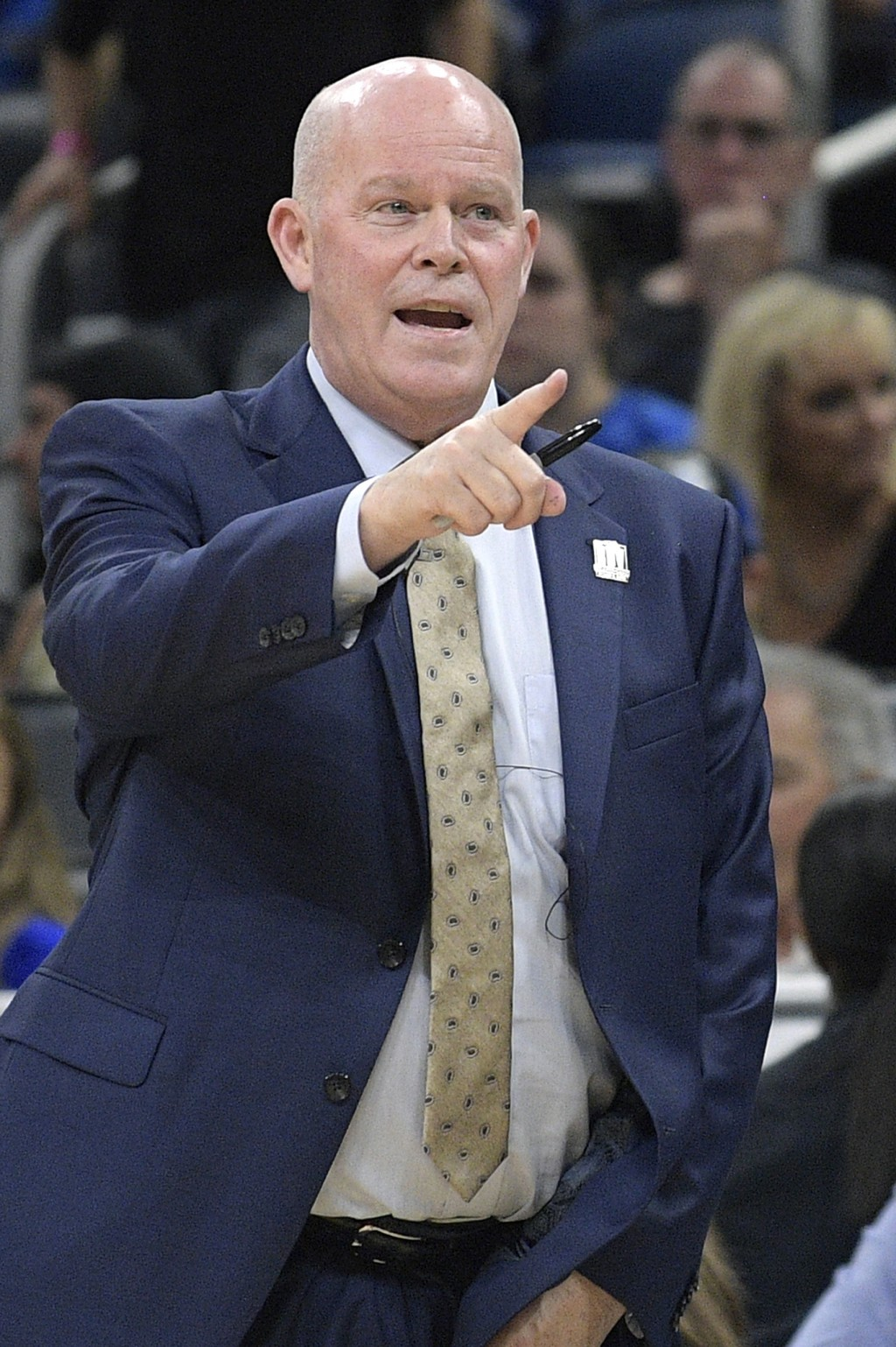 Orlando Magic coach Steve Clifford calls out instructions during the first half of the team's NBA basketball game against the Los Angeles Clippers on